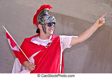 Gladiator in Red - Youn man in his 20s celebrating Canada...