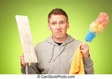 Man unhappy to clean the house - Man unhappy, confused and...