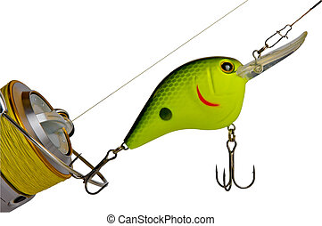 Fishing tackle - A fishing lure and reel, isolated on a...