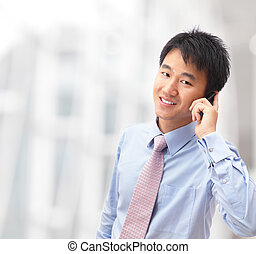 handsome business man speaking mobile phone at his company...