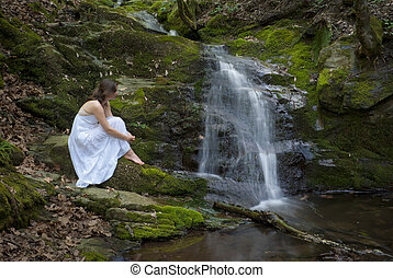 Contemplating Nature - Beautiful young woman in a white...
