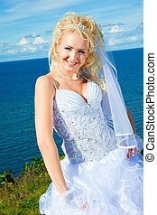 beautiful bride on a sea coast