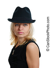 serious woman with a black hat