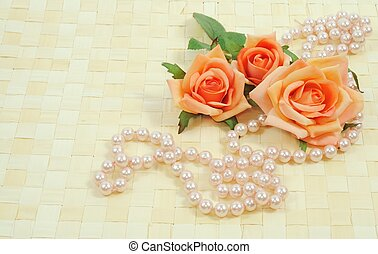 Roses and pearls - Framework on wooden background from roses...