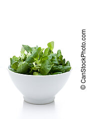 valerian leaf salad on a bowl