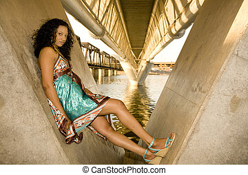 Model in Urban waterfront Setting - African-american Fashion...