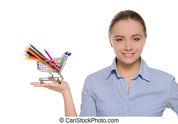 Woman with colored pencils in shopping trolley