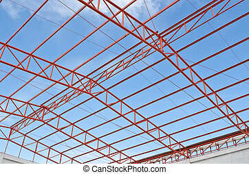 Steel roof trusses sitting on concrete pole view from inside...