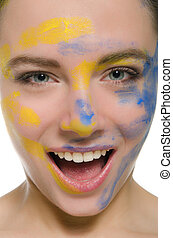 smiling woman with paint on his face