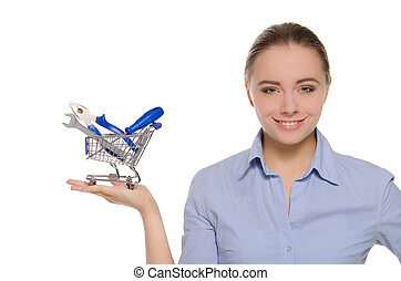 Woman with tools in shopping trolley