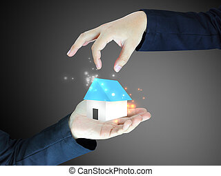 Concept image of a hand holding house