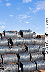 Steel wire - Shiny naked steel wire coils in warehouse on...