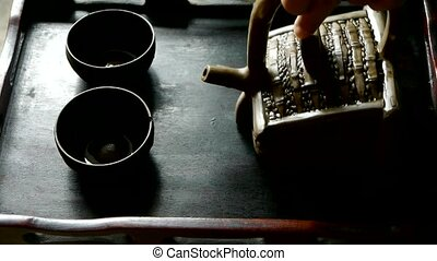 Teapot pouring tea,ancient customs of leisure.china,japan.
