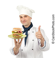 Chef holding a plate with big sandwich