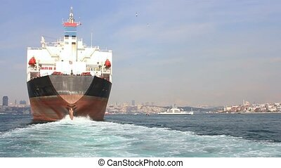Large ship sailing through Straits - Back view of the oil...