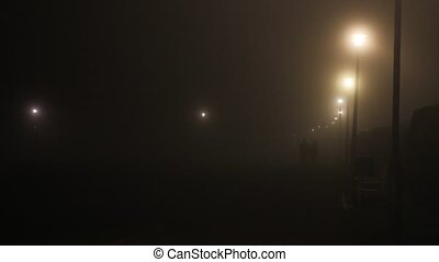 Couple walking in a foggy night. - Couple walking in a foggy...