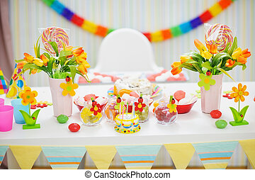 Closeup on table decorated for childrens celebration party
