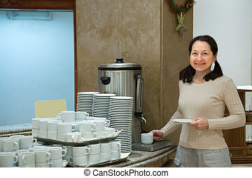 Woman pours tea
