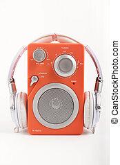 Radio with headphones - orange retro looking radio with...