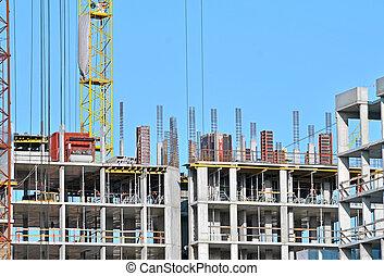 Building construction site against blue sky