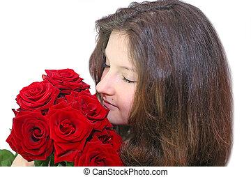 Girl enjoys the smell of roses