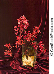 still life in red tones with vase in modern style, fabric...