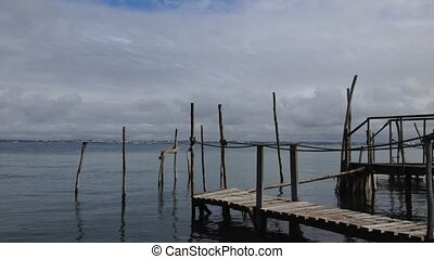 Old wood piers - Timelapse of old wood piers, clouds in the...