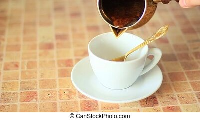 Pour coffee in white cup from gold - Pour organic coffee in...