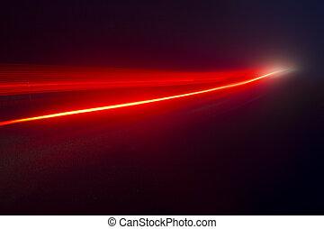 Light Streak - Processed photograph of a red streak of light