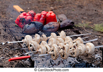 Mushrooms, eggplants and red pepper on bbq grill