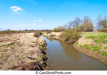 Muddy river - dirty, muddy river and the landscape after the...
