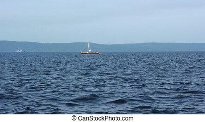 Sailboat in regatta on blue sea