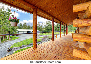 Long cabin horse farm house porch. - Long cabin horse farm...