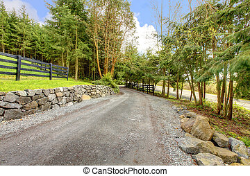 Horse farm rural road with fence. - Horse farm rural road...