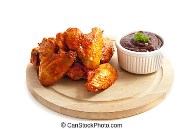 Hot wings - Chicken wings on wooden plate isolated over...