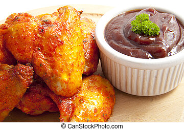 Spicy chicken - Tasty chicken with red sauce on wooden plate