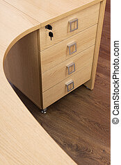 wooden desk with drawers in a modern office