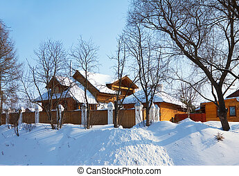 Wooden house in winter street at Suzdal Russia