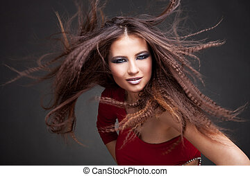 beautiful woman with magnificent hair blown