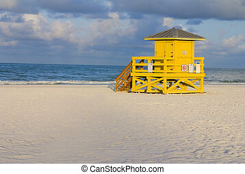 Lifeguard Hut Yellow - A yellow wooden lifeguard hut on an...