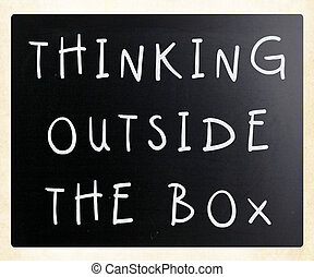 Thinking outside the box phrase, handwritten with white...
