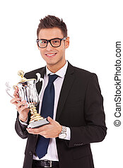 business man holding a trophy