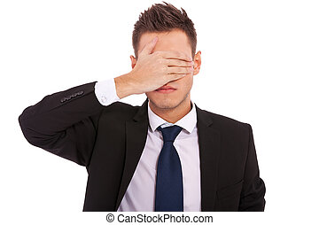 business man making the see no evil gesture over white ....