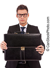serious business man offering a briefcase - serious business...