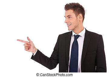 young business man pointing to the side