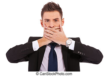 business man making the speak no evil gesture