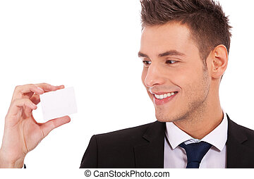 business man looking at a card