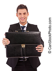 business man offering a black briefcase - smiling young...