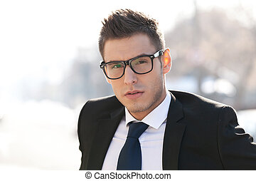 executive wearing glasses - Head shot of executive wearing...