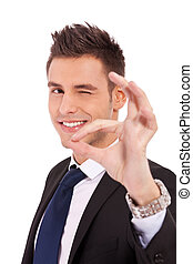 Business man winking with ok sign